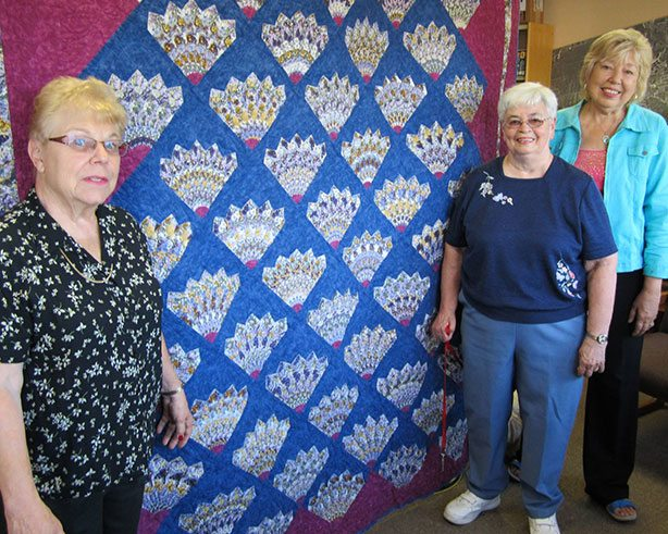 2 ladies in front of a quilt at the Arts & Crafts Fair Cambridge
