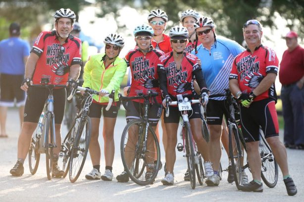 Bikers lined up and smiling at the Lake Ripley Ride Cambridge