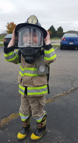 Child in Fireman's uniform
