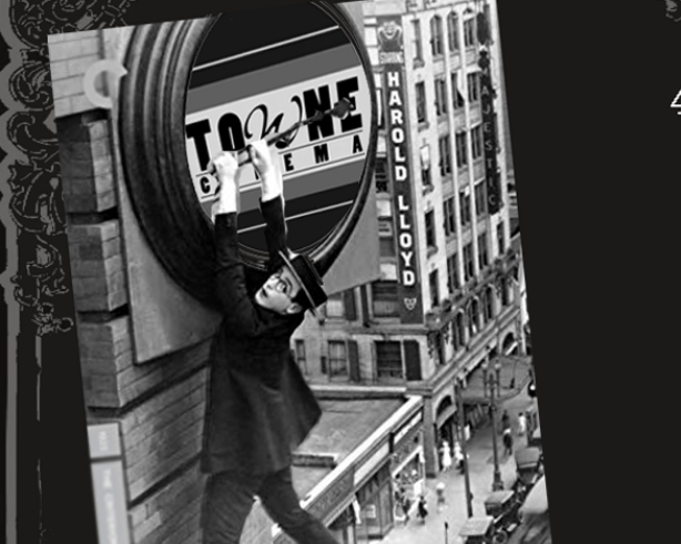 Black and white movie pic-man hanging from sign.