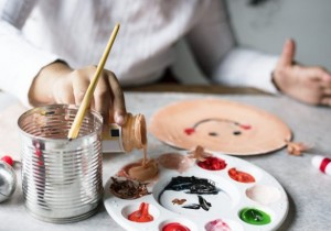 Child painting a craft