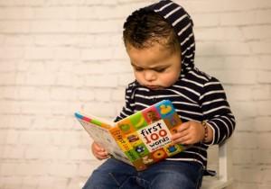 Toddler reading a book