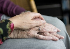 Two elderly hands, one resting on the other.