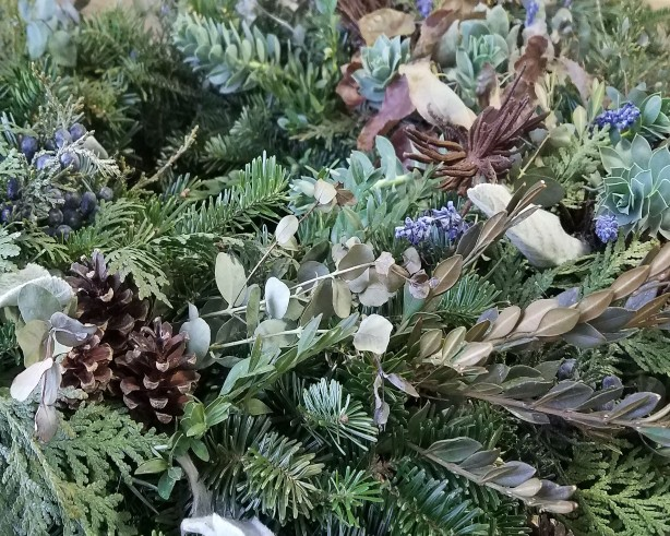 evergreen wreath with pinecones berries succulents