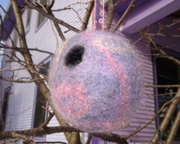 felted bird pod hanging in tree