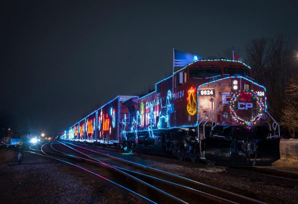 CP Holiday Train at night with holiday lights