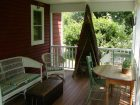 Front Porch with table & chairs at Bartel's Beach Cottage, Lake Mills, WI