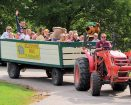 Tractor pulling a wagon with people at Yogi at Jellystone Park Campground